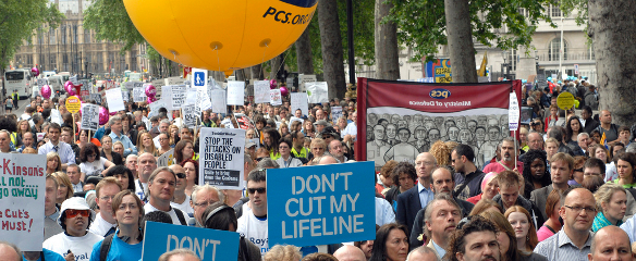 Photo of a large crowd of campaigners at the Hardest Hit march in May 2011