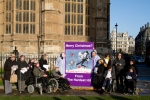 Supporters of the Hardest Hit Campaign and our delegation stand with our giant Christmas Card outside Parliament