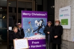 The Hardest Hit Delegation stand next to our giant Christmas Card with a smaller copy that we prepared to give to the DWP
