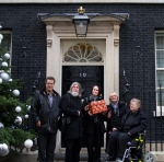 The Hardest Hit Delegation stand outside Downing St with the box containing the full list of Hardest Hit Christmas Card Signatures