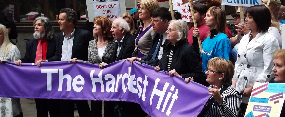 Photo of the large Hardest Hit banner at the front of the march in May, 2011